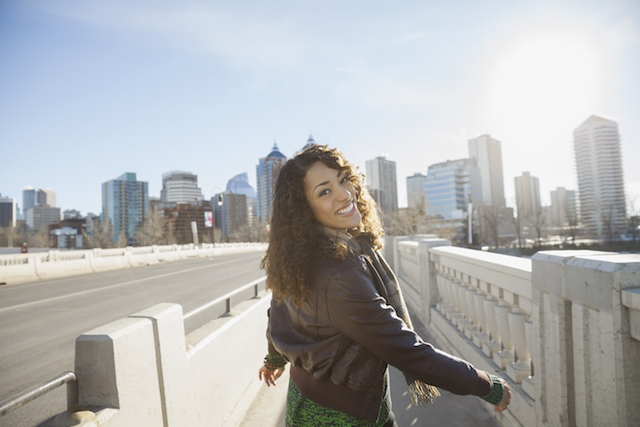 Woman smiling walking through a city