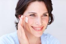 Woman applying NEUTROGENA® face moisturizer