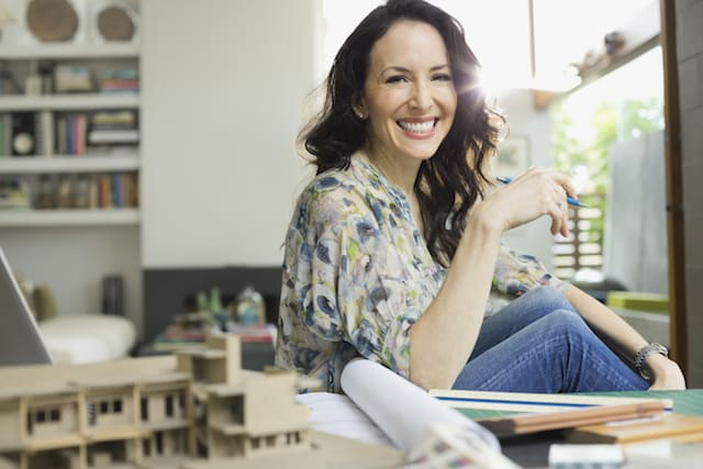 Woman smiling in a studio apartment