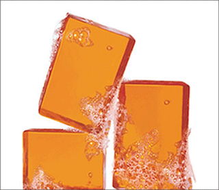 Stack of NEUTROGENA® bar soaps with bubbles
