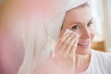 Woman applying NEUTROGENA® face toner